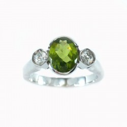 Ring in white gold, peridot and cubic zirconia