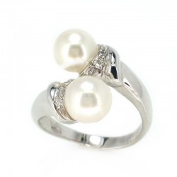 Ring the contrary in white gold, pearls and diamonds