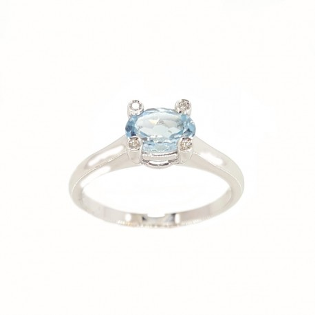 Ring in white gold with topaz and diamonds